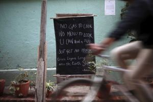 A notice displayed outside a Kathmandu restaurant informing customers they have no cooking gas. (Pic Reuters, Navesh Chitrakar)
